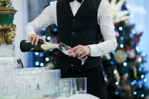 Image of a waiter serving champagne